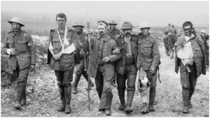 "The ""War to End All Wars,"" like all the wars that have followed it, discarded human lives on all sides. Here, a German prisoner helps British wounded make their way to a dressing station. Image:  Imperial War Museum"